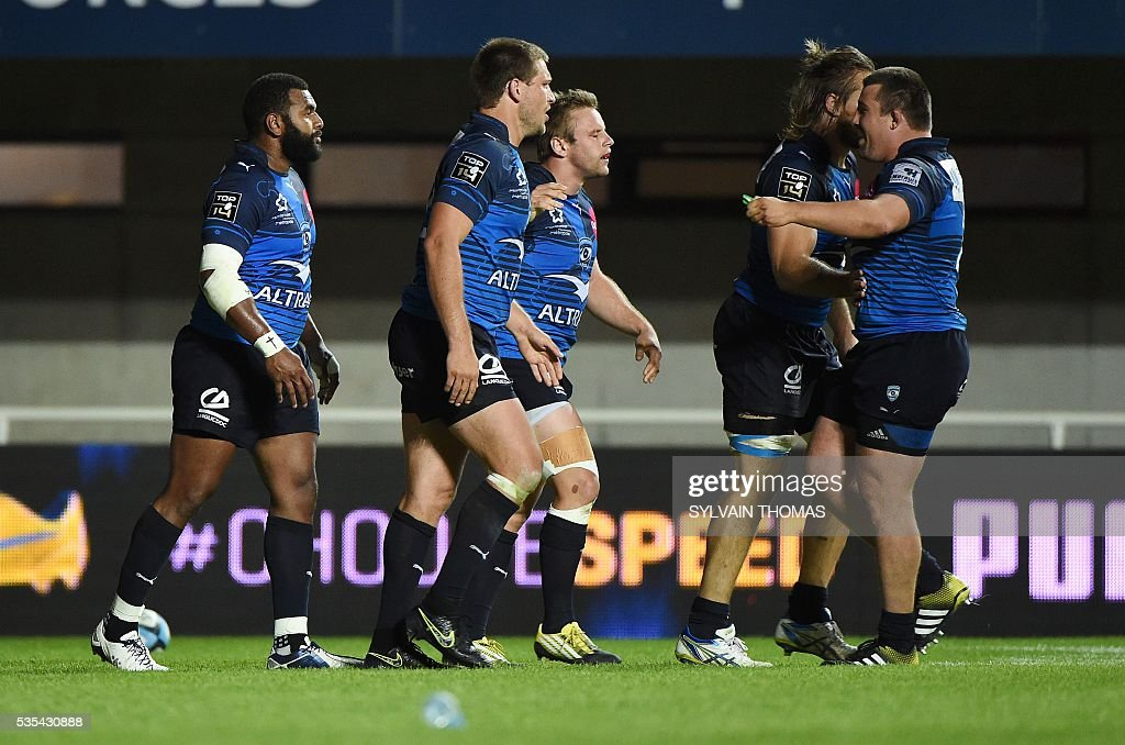 Montpellier's Timoci Nagusa (L) is congratulated by teammates after scoring a try during the French Top 14 rugby Union match Montpellier vs Toulon, on May 29, 2016, at the Altrad stadium, in the French southern city of Montpellier.