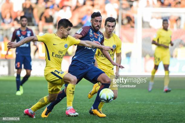 Montpellier's Uruguayan midfielder Facundo Piriz Paris SaintGermain's Spanish defender Yuri Berchiche and Paris SaintGermain's Argentinian midfielder...