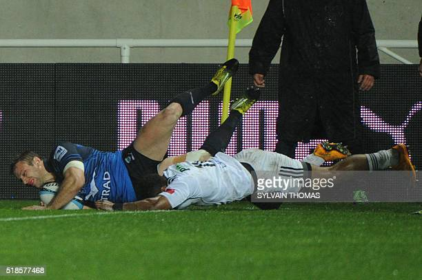 Montpellier's Wing Marvin O'Connor scores a try during the French Top 14 Rugby Union match Montpellier vs Brive on April 1 at the Altrad stadium in...