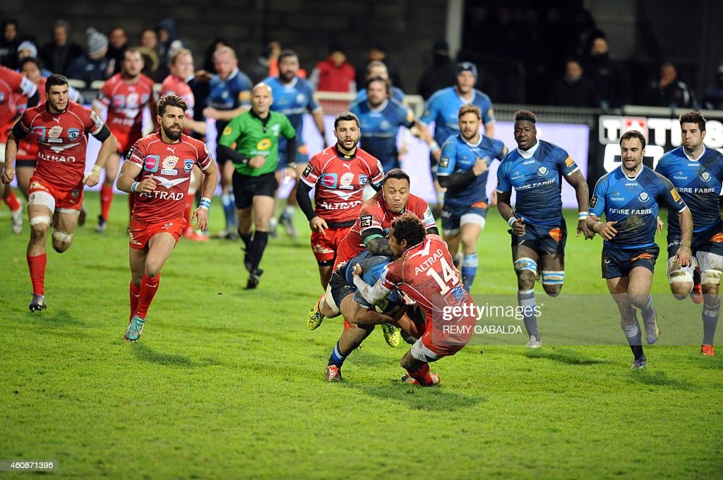 Montpellier's winger <a gi-track='captionPersonalityLinkClicked' href=/galleries/search?phrase=Benjamin+Fall&family=editorial&specificpeople=5405287 ng-click='$event.stopPropagation()'>Benjamin Fall</a> (Front-C) collides with Castres French fly-half Remi Tales (C) during the French Top 14 rugby union match Castres vs Montpellier on December 28, 2014 at the Pierre-Antoine stadium in Castres.