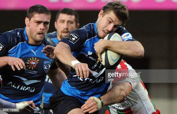 Montpellier's Yohan Audrin runs with the ball during the French Top 14 rugby Union match Montpellier vs Biarritz on December 29 at Yves du Manoir...