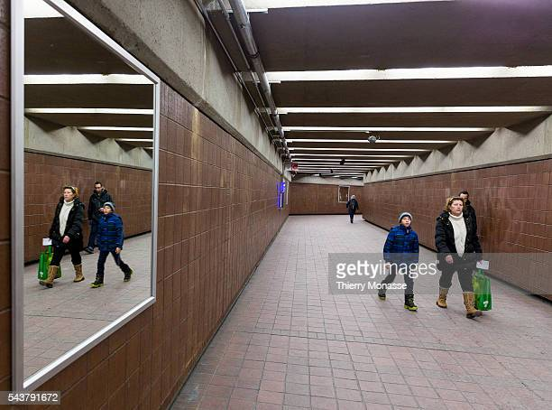 Montréal Québec Canada January 5 2016 People are walking in the Montreal Metro The Métro de Montréal is a rubbertired underground metro system and...