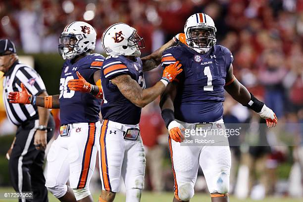 Montravius Adams of the Auburn Tigers reacts after nearly intercepting a deflected pass against the Arkansas Razorbacks in the third quarter of the...