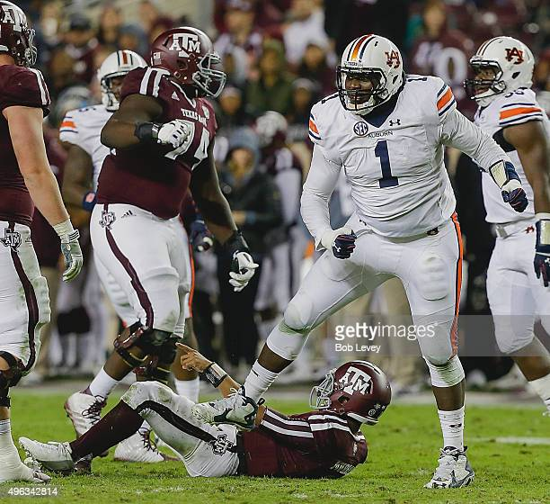 Montravius Adams of the Auburn Tigers stands over Kyler Murray of the Texas AM Aggies after sacking him at Kyle Field on November 7 2015 in College...
