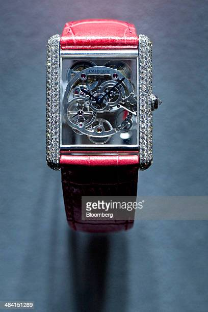 A Montre Tank Louis Cartier Squelette Saphir luxury wristwatch manufactured by Cartier a luxury unit of Cie Financiere Richemont SA sits on display...