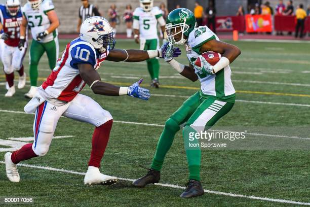 Montreal Alouettes linebacker Chris Ackie getting to Saskatchewan Roughriders wide receiver Duron Carter after he received the ball during the...