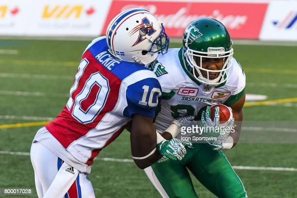 Montreal Alouettes linebacker Chris Ackie grabbing Saskatchewan Roughriders wide receiver Duron Carter during the Saskatchewan Roughriders versus the...