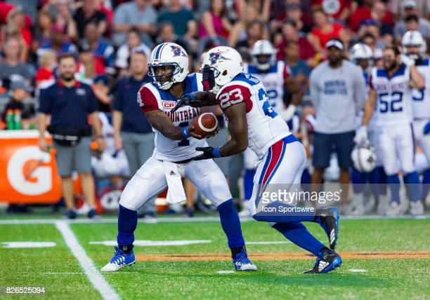 Montreal Alouettes quarterback Darian Durant hands the ball of to running back Brandon Rutley during Canadian Football League action between Montreal...