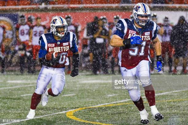 Montreal Alouettes running back Tyrell Sutton running with the ball while Montreal Alouettes guard Kristian Matte protects him during the Calgary...