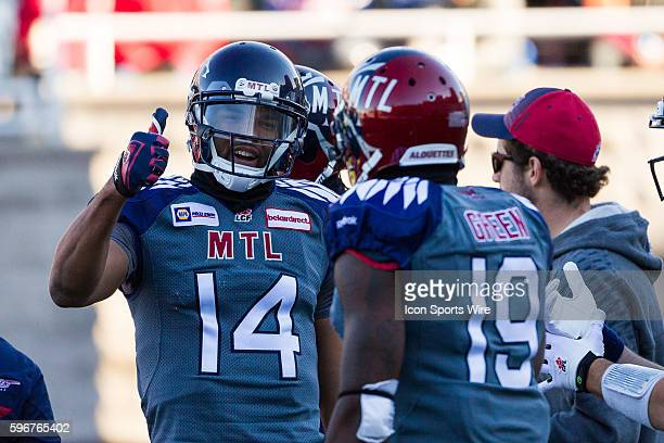 Montreal Alouettes wide receiver Brandon London gives a thumbsup to Montreal Alouettes slotback SJ Green during the game between the Toronto...