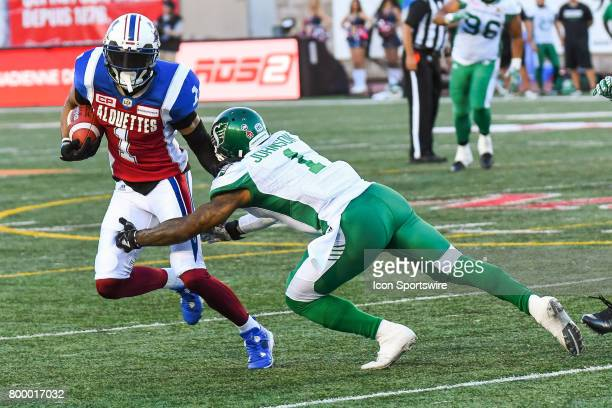 Montreal Alouettes wide receiver Tiquan Underwood running with the ball just before being tackled by Saskatchewan Roughriders defensive back Jovon...