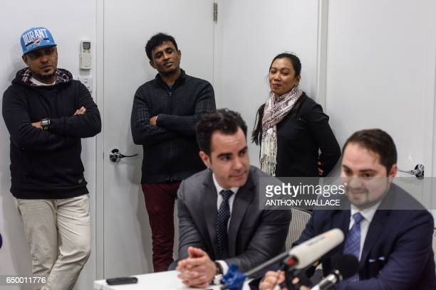Montreal based Canadian lawyers Francis Tourigny and MarcAndre Seguin speak during a press conference attended by their clients Sri Lankan asylum...