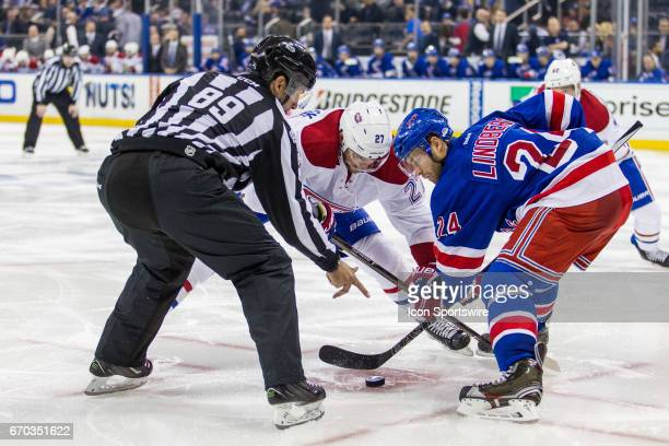 Montreal Canadiens center Alex Galchenyuk and New York Rangers center Oscar Lindberg face off in the Rangers zone during the third period of game 4...