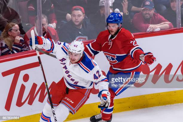 Montreal Canadiens center Alex Galchenyuk holding New York Rangers defenseman Brendan Smith during the first period of Game One of the Eastern...