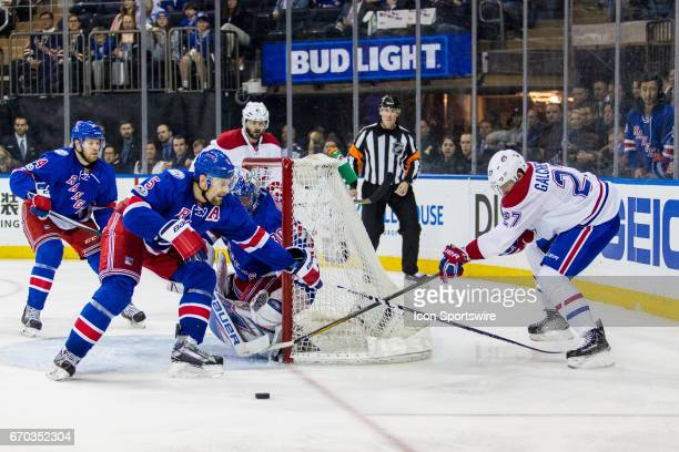 Montreal Canadiens center Alex Galchenyuk throws the puck in front of the NY Rangers net during the third period of game 4 of the first round of the...