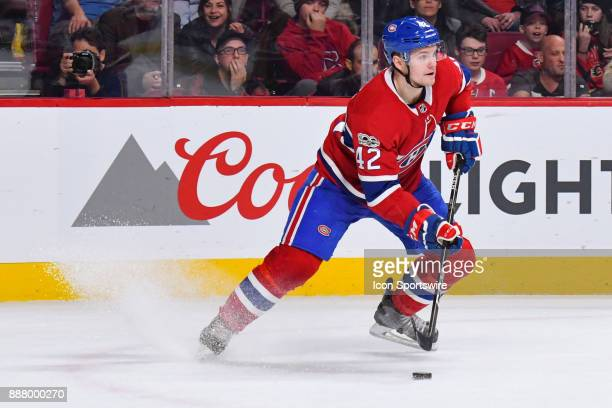 Montreal Canadiens Center Byron Froese breaks and gains control of the puck during the Calgary Flames versus the Montreal Canadiens game on December...