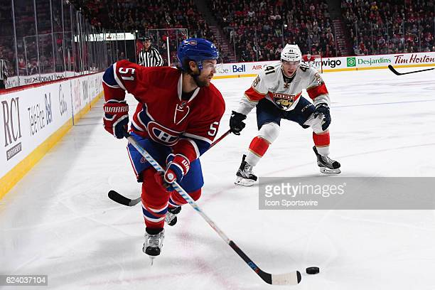 Montreal Canadiens Center David Desharnais controlling the puck while Florida Panthers Left Wing Greg McKegg wathces him during the Florida Panthers...