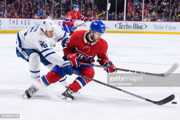 Montreal Canadiens center Jonathan Drouin and Toronto Maple Leafs left wing Matt Martin fights for the puck during the second period of the NHL game...