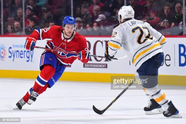 Montreal Canadiens Center Jonathan Drouin skates towards Buffalo Sabres Center Johan Larsson during the Buffalo Sabres versus the Montreal Canadiens...
