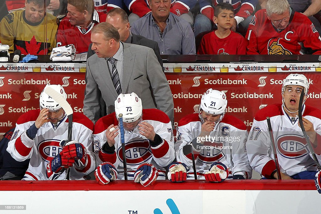 Montreal Canadiens coach <a gi-track='captionPersonalityLinkClicked' href=/galleries/search?phrase=Michel+Therrien&family=editorial&specificpeople=241575 ng-click='$event.stopPropagation()'>Michel Therrien</a> speaks to his players during the game against the Ottawa Senators in Game Three of the Eastern Conference Quarterfinals during the 2013 NHL Stanley Cup Playoffs at Scotiabank Place on May 5, 2013 in Ottawa, Ontario, Canada.