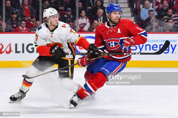 Montreal Canadiens Defenceman Shea Weber and Calgary Flames Defenceman TJ Brodie both look towards the play and change direction during the Calgary...