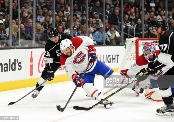 Montreal Canadiens Defenseman Shea Weber clears the puck away from Los Angeles Kings Right Wing Dustin Brown during an NHL game between the Montreal...