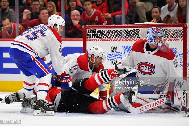 Montreal Canadiens defenseman Shea Weber falls on top of Chicago Blackhawks right wing John Hayden near the goal as Montreal Canadiens right wing...
