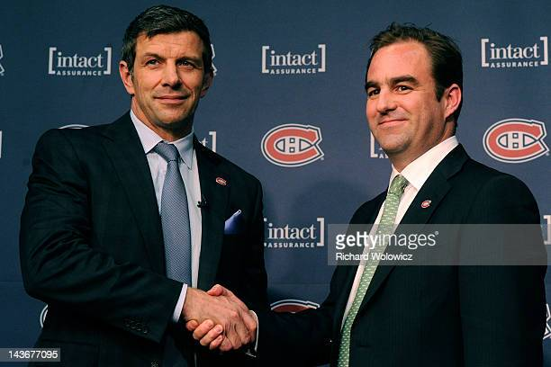 Montreal Canadiens General Manager Marc Bergevin and team owner Geoff Molson shake hands after a press conference introducing Bergevin as the new...