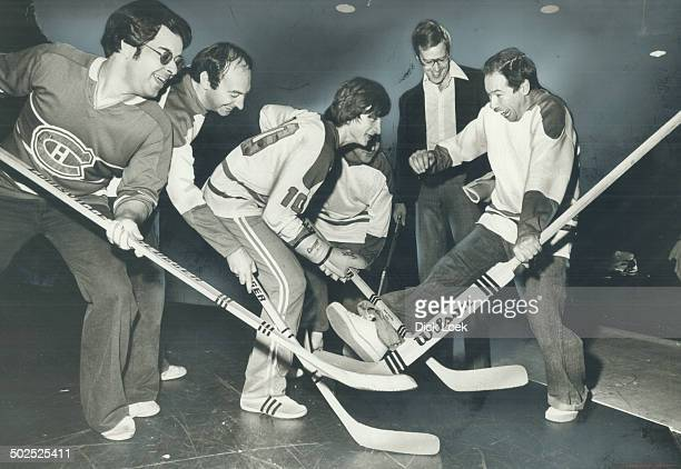 Montreal Canadiens goaie Ken Dryden hams it up with the cast of Les canadiens from left to right Jeff Braunstein Pierre Lenoir Sebastien Chavernas...