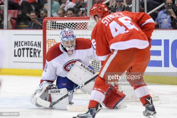 Montreal Canadiens goalie Charlie Lindgren blocks this close shot by Detroit Red Wings center Ben Street during the NHL hockey game between the...
