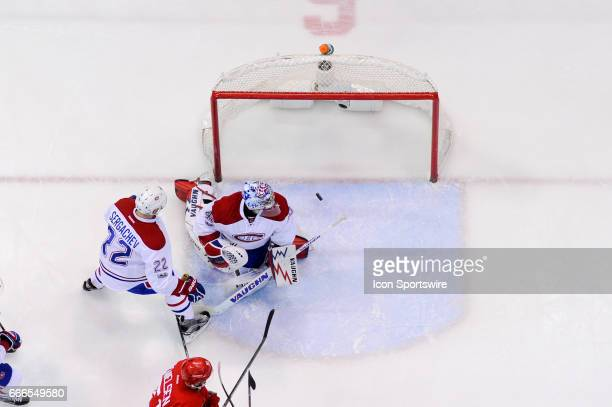 Montreal Canadiens goalie Charlie Lindgren watches this goal slip past him during the NHL hockey game between the Montreal Canadiens and Detroit Red...