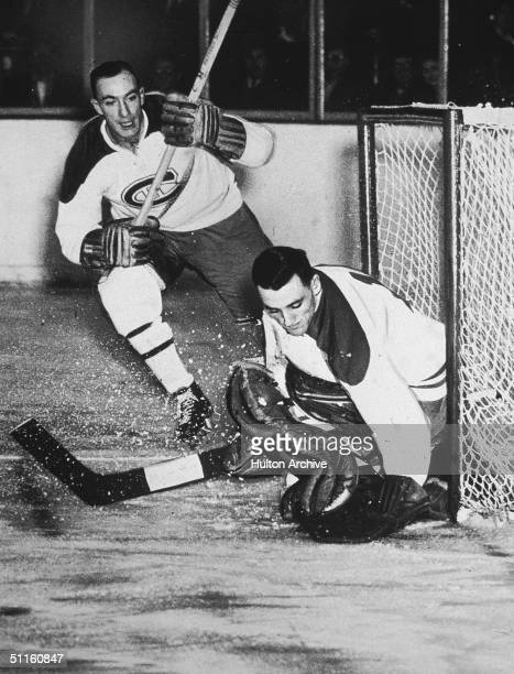 Montreal Canadiens goalkeeper Jacques Plante makes a save as teammate Bud McPherson watches stick raised 1954