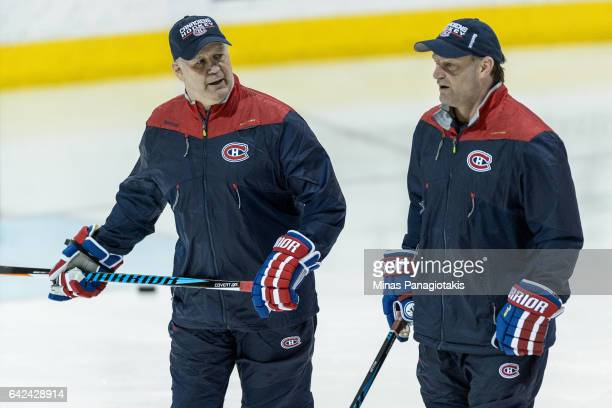 Montreal Canadiens head coach Claude Julien speaks with associate coach Kirk Muller during the Montreal Canadiens practice session at the Bell Sports...