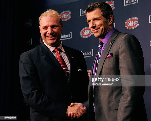 Montreal Canadiens Head Coach Michel Therrien and General Manager Marc Bergevin shake hands and pose for photos after Therrien was introduced as the...