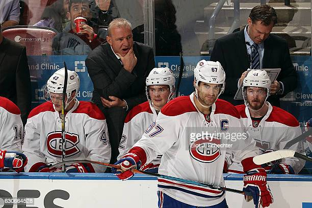 Montreal Canadiens Head Coach Michel Therrien keeps an eye on his team from the bench against the Florida Panthers at the BBT Center on December 29...