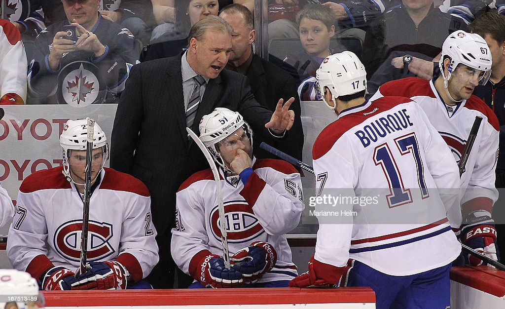 Montreal Canadiens' head coach <a gi-track='captionPersonalityLinkClicked' href=/galleries/search?phrase=Michel+Therrien&family=editorial&specificpeople=241575 ng-click='$event.stopPropagation()'>Michel Therrien</a> speaks with Rene Bourque #17 as he gets off the ice during third period NHL action on April 25, 2013 at the MTS Centre in Winnipeg, Manitoba, Canada.