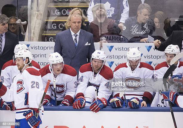Montreal Canadiens head coach Michel Therrien watches during a break in the action in the first period in a game against the Toronto Maple Leafs at...