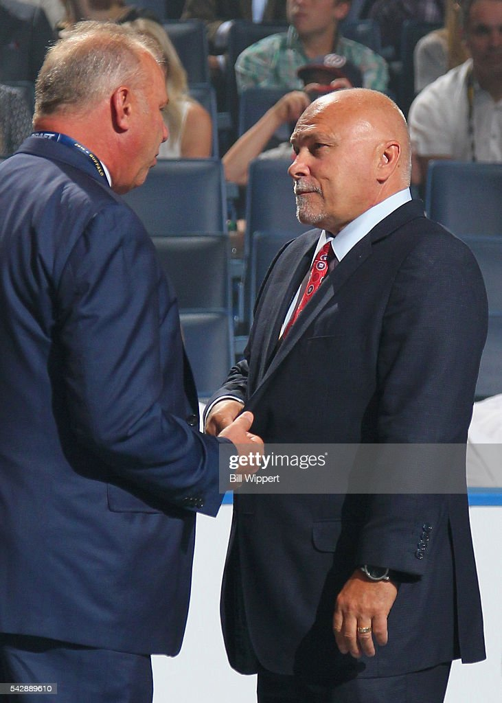 Head coach <a gi-track='captionPersonalityLinkClicked' href=/galleries/search?phrase=Barry+Trotz&family=editorial&specificpeople=212800 ng-click='$event.stopPropagation()'>Barry Trotz</a> of the Washington Capitals, right, and head coach <a gi-track='captionPersonalityLinkClicked' href=/galleries/search?phrase=Claude+Julien&family=editorial&specificpeople=582124 ng-click='$event.stopPropagation()'>Claude Julien</a> of the Boston Bruins talk on the draft floor during round one of the 2016 NHL Draft at First Niagara Center on June 24, 2016 in Buffalo, New York.
