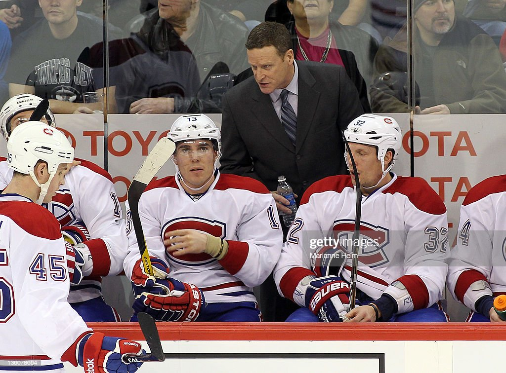 Montreal Canadiens head coach Randy Cunneyworth gives direction from the bench in a game against the Winnipeg Jets in NHL action at the MTS Centre on December 22, 2011 in Winnipeg, Manitoba, Canada.