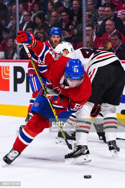 Montreal Canadiens Left Wing Charles Hudon fights to gain control of the puck during the Chicago Blackhawks versus the Montreal Canadiens game on...