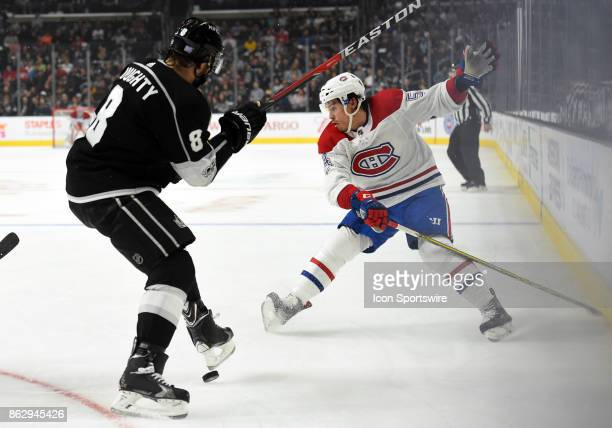 Montreal Canadiens Left Wing Charles Hudon lifts his skate up to try and deflect a pass by Los Angeles Kings Defenseman Drew Doughty during an NHL...