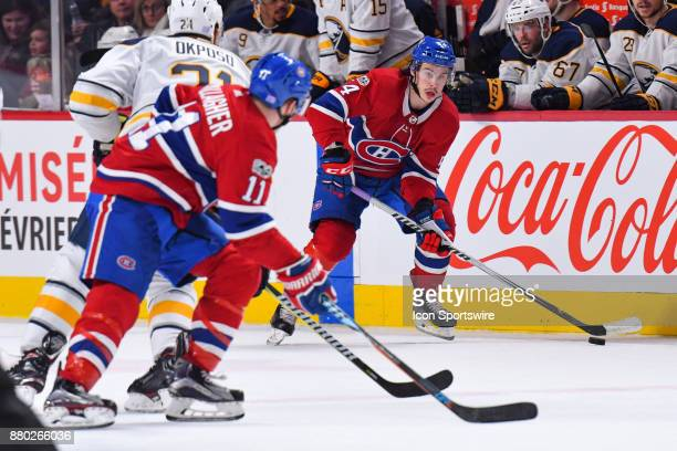 Montreal Canadiens Left Wing Charles Hudon passes the puck to Montreal Canadiens Right Wing Brendan Gallagher during the Buffalo Sabres versus the...