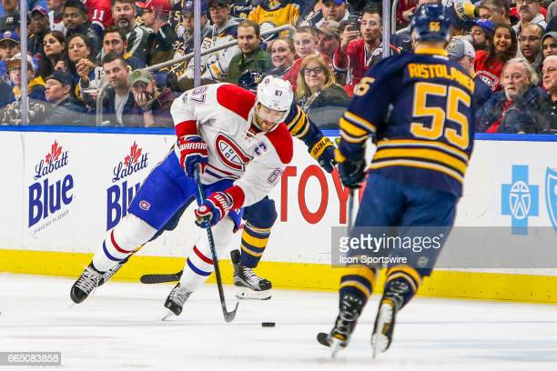 Montreal Canadiens Left Wing Max Pacioretty skates with the puck as Buffalo Sabres Left Wing Evander Kane and Buffalo Sabres Defenseman Rasmus...