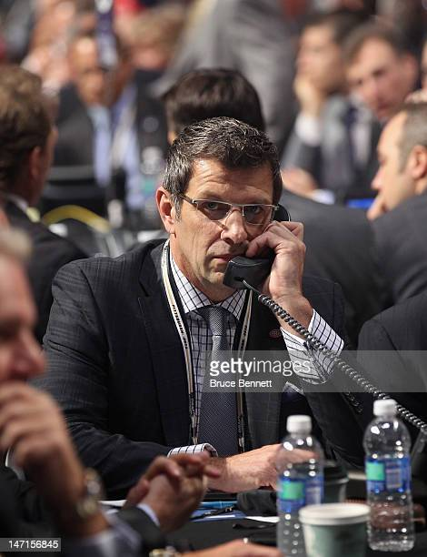 Montreal Canadiens Marc Bergevin speaks on the phone during Round One of the 2012 NHL Entry Draft at Consol Energy Center on June 22 2012 in...