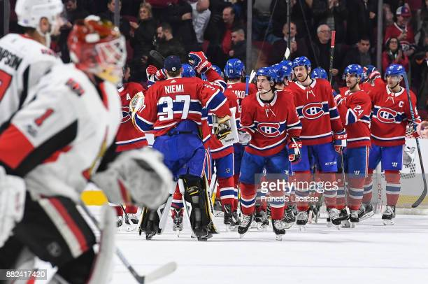Montreal Canadiens players celebrate after defeating the Ottawa Senators in the NHL game at the Bell Centre on November 29 2017 in Montreal Quebec...