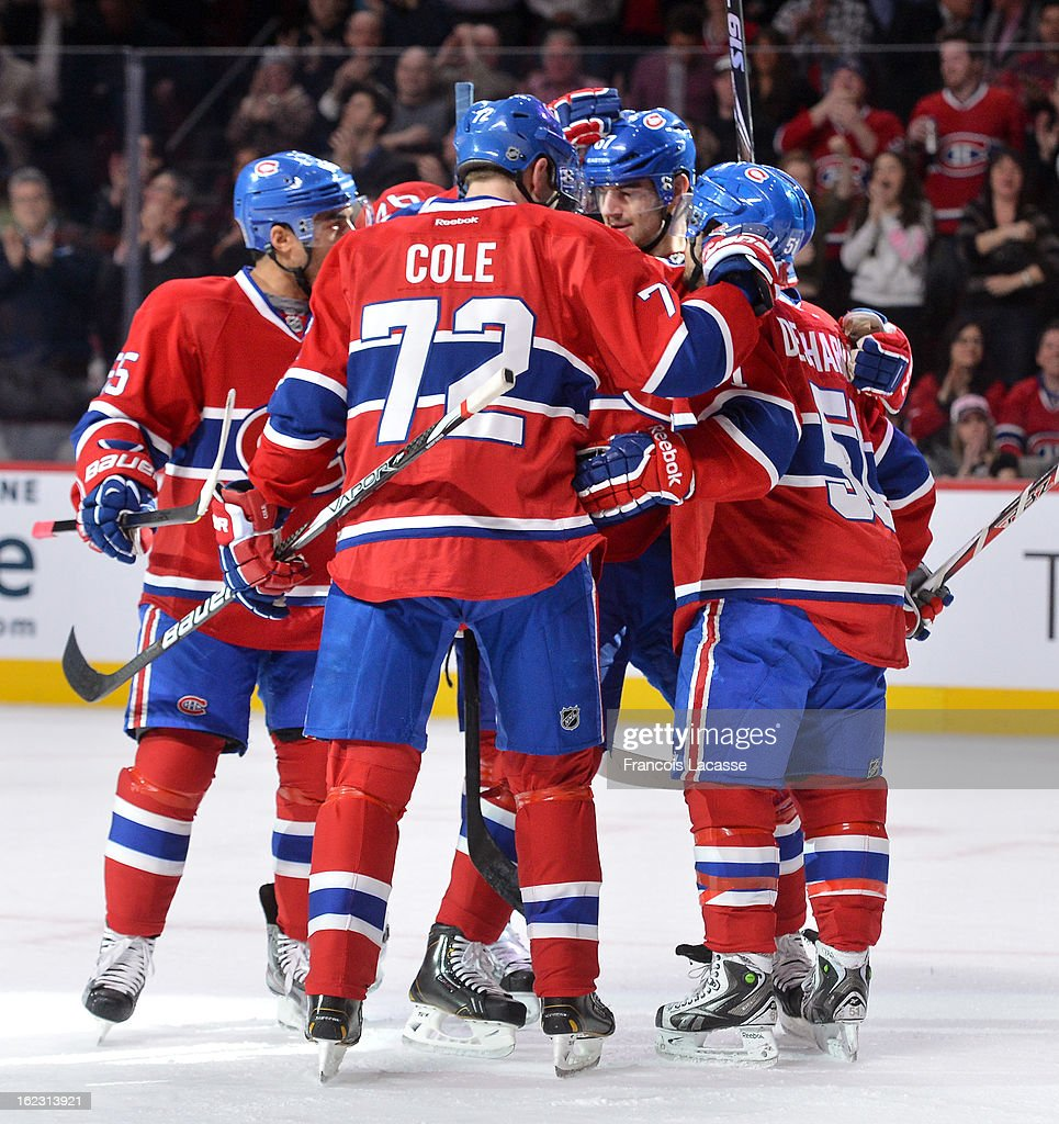 Montreal Canadiens players celebrrate a goal during the NHL game against New York Islanders on February 21, 2013 at the Bell Centre in Montreal, Quebec, Canada.