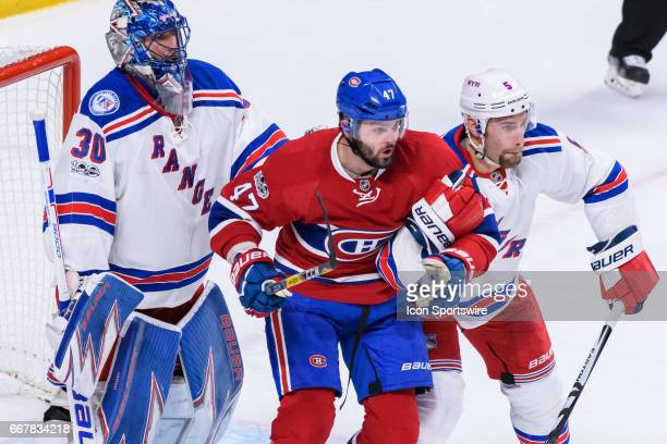 Montreal Canadiens right wing Alexander Radulov and New York Rangers defenseman Dan Girardi battle for positions during the first period of Game One...