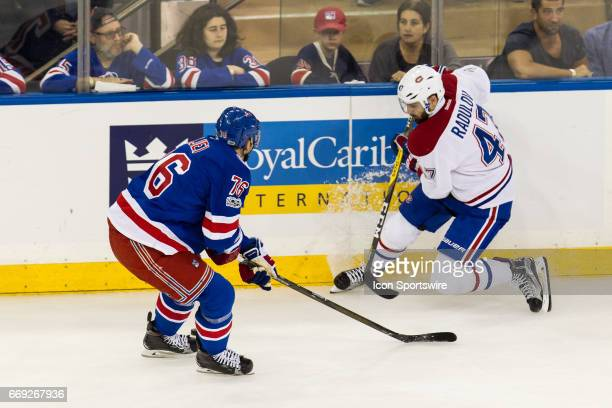 Montreal Canadiens right wing Alexander Radulov dumps the puck around New York Rangers defenseman Brady Skjei during the first period of game 3 of...