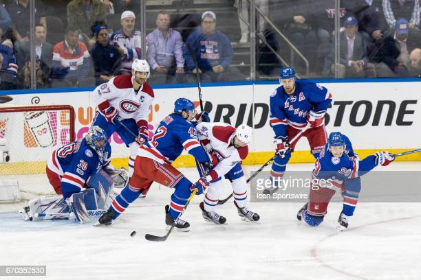 Montreal Canadiens right wing Alexander Radulov dumps the puck back to the Rangers net during the second period of game 4 of the first round of the...