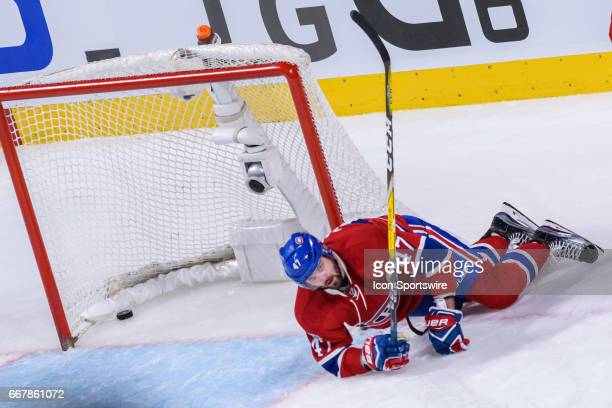 Montreal Canadiens right wing Alexander Radulov lays on the ice after the empty net goal of the New York Rangers during the third period of Game One...
